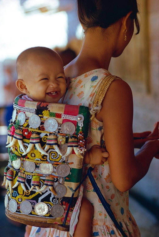 Kenyah woman with baby in a traditional carrier, Kalimantan, Borneo, Indonesia, Asia